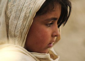 A young Afghan girl listens to a story