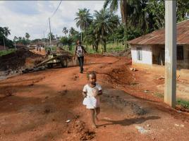 A little girl runs towards me, 'Aporto', in Makeni, a few days before the Sierra Leone Marathon hosted by Street Child of Sierra Leone.