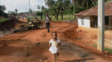 A little girl runs towards me, 'Aporto', in Makeni, a few days before the Sierra Leone Marathon hosted by Street Child of Sierra Leone.