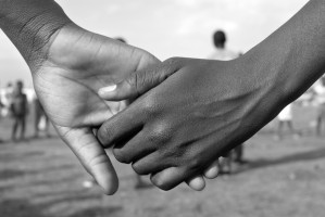 holding hands haiti and dominican republic