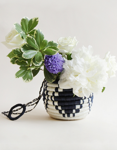 Hanging Flower Pot, $45 - Hand woven by the artisans of Imirasire in Rwanda out of sweetgrass locally grown in Rwanda.