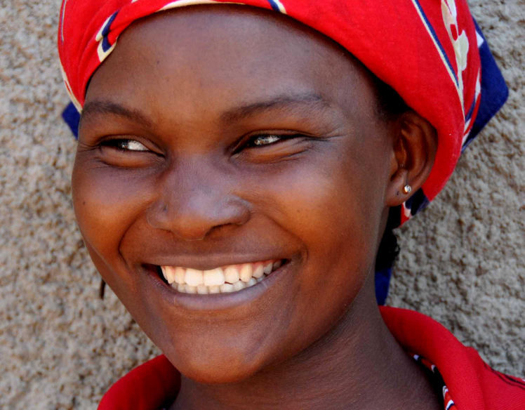 Ugandan woman photo via Shutterstock