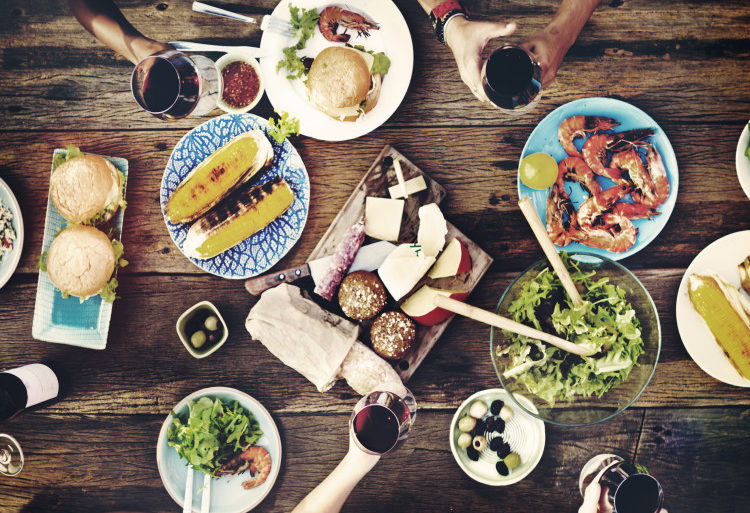 aerial view of table with food and hands
