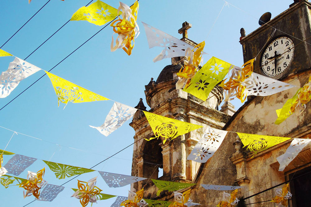 Tepoztlan-flags-waving-from-churchCROP